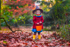 Little girl in witch costume at Halloween Stock Photos