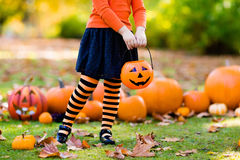 Little girl in witch costume on Halloween trick or treat Royalty Free Stock Images
