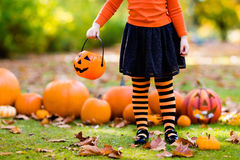 Little girl in witch costume on Halloween trick or treat Stock Photos
