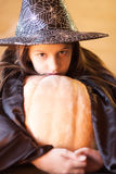 Little girl in witch costume is ready for Trick or Treat Stock Image