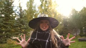 Little girl in witch costume roaring at camera, frightening viewers, Halloween. Stock photo stock images