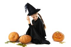 Halloween. portrait of little girl in witch costume stock photos