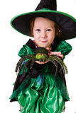 Little girl in a witch costume with a toy in the hands of a spid Stock Images