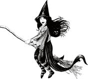 Little girl witch. Little witch flying on her broom develop her dress and hair Stock Photos