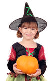 Little girl witch holding pumpkin Royalty Free Stock Photos