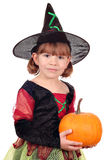 Little girl witch with pumpkin Royalty Free Stock Image