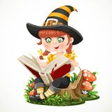 Little girl witch sitting on a tree stump and reads magic book Royalty Free Stock Photos