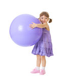 Little Girl With A Big Purple Ball Royalty Free Stock Image