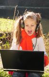 Little Girl With A Laptop Stock Images