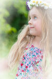 Little Girl With A Wreath Of Flowers Stock Images