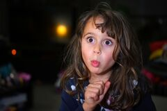 Free Little Girl With Big Eyes Make Funny Faces, With Copy Space Stock Photo - 176955090