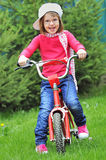 Little Girl With Bike Royalty Free Stock Photos