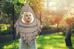 Free Little Girl With Cardboard Rocket Dreaming About Flying In Space And Astronaut Profession In Future. Imagination, Freedom And Royalty Free Stock Photo - 197080735