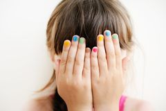 Little Girl With Hands Covering Her Eyes Stock Photos