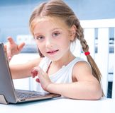 Little Girl With Her Computer Stock Photos