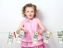 Little Girl With Money Stock Photo