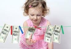 Little Girl With Money Stock Photos