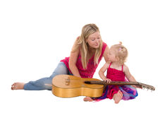 Little Girl With Mother Playing Guitar Royalty Free Stock Images