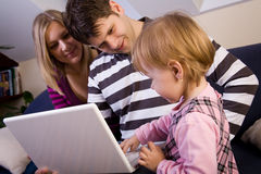 Little Girl With Parents Play With Laptop Royalty Free Stock Photography