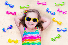 Free Little Girl With Sun Glasses On A Beach Royalty Free Stock Photo - 55566955
