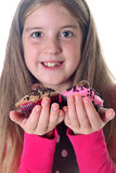 Little Girl With Two Cupcakes Royalty Free Stock Image