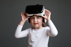 Free Little Girl With Virtual Reality Headset. Innovative Technology And Education Concept Royalty Free Stock Images - 216753779