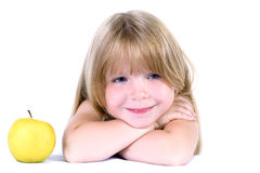 Little Girl With Yellow Apple Royalty Free Stock Photo