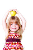 Little Girl With Yellow Apple Royalty Free Stock Image