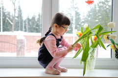 Little girl wiyh tulips in the winter Royalty Free Stock Photography