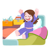 Little girl woke up and stretching in bed Royalty Free Stock Photography