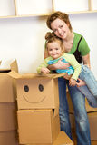 Little girl and woman with cardboard boxes Stock Image