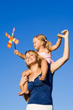 Little girl and woman with a pinwheel toy outdoors Stock Photography