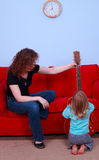 Little girl and woman play with electric guitar Royalty Free Stock Photography