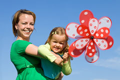 Little girl and woman playing outdoors Royalty Free Stock Images