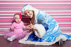 Little girl and woman in suit of a Snow Maiden Royalty Free Stock Image