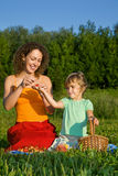 Little Girl and Women keeps in hand sweet cherries Stock Photos