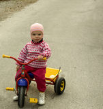 Little girl wondering Stock Photo