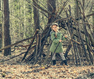 Little girl in the wood near  hut Royalty Free Stock Photography