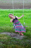 Little girl on wood swing Royalty Free Stock Photo