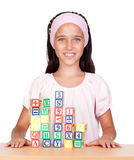 Little girl with with wooden blocks stacked Stock Image