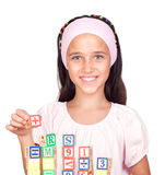 Little girl with with wooden blocks stacked. Isolated on white background Stock Image