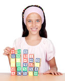 Little girl with with wooden blocks stacked Stock Photos