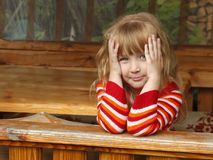 Little girl in wooden canopy outdoor Royalty Free Stock Image