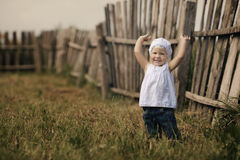 Little girl and wooden fence Stock Photo