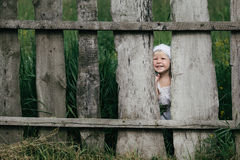 Little girl and wooden fence Stock Image