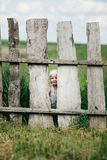 Little girl and wooden fence Royalty Free Stock Images