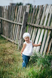 Little girl and wooden fence Stock Photography