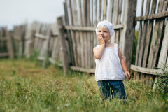 Little girl and wooden fence Royalty Free Stock Photos