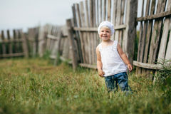 Little girl and wooden fence Royalty Free Stock Photo