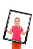 Little girl in wooden frame. Stock Photos
